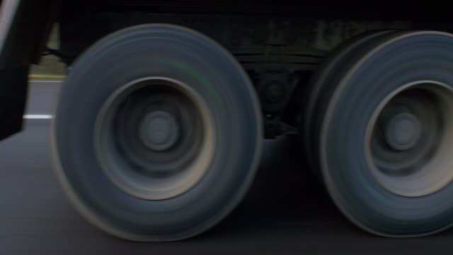low angle side view of lorry on motorway - lastzug stock-videos und b-roll-filmmaterial