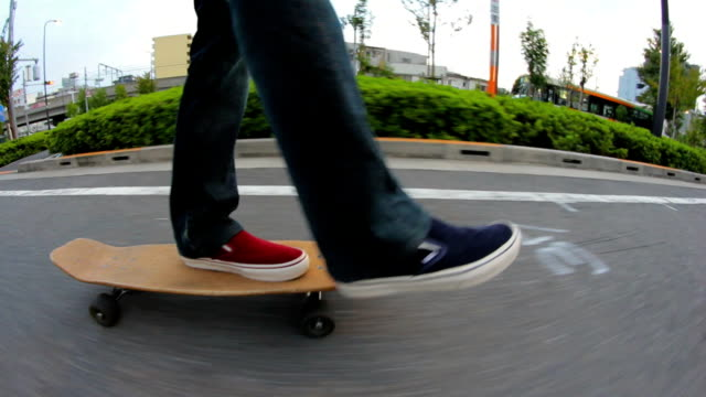 low angle side view shot,skateboard cruising,tokyo,japan - skateboard stock videos and b-roll footage