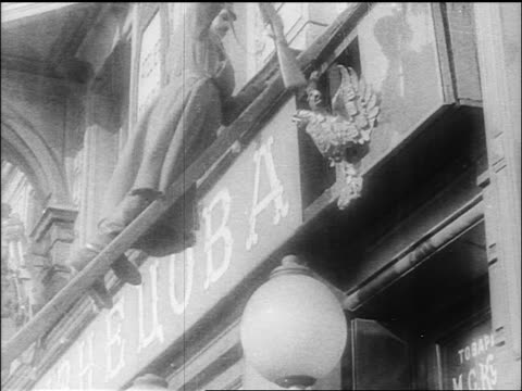 b/w 1918 low angle soldier on sign dismantling emblem of czar's rule / russia / documentary - 1918 stock videos and b-roll footage