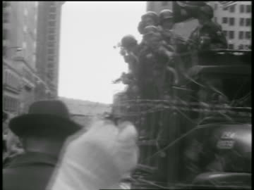 low angle soldiers on truck in parade passing audience / after korean war / seattle - 1954 stock videos & royalty-free footage