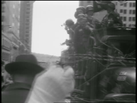 b/w 1954 low angle pan soldiers on truck in parade passing audience / after korean war / seattle - 1954 stock videos & royalty-free footage