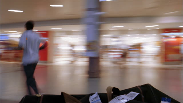 low angle spinning point of view time lapse in airport terminal - spinning point of view stock videos & royalty-free footage