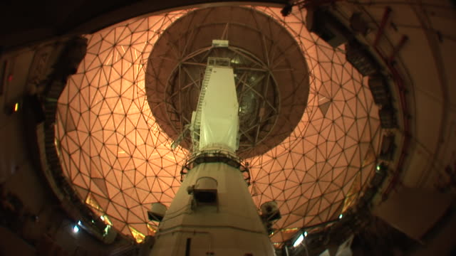 Low Angle static _ A radio telescope rotates in circles / Cambridge, Massachusetts, USA
