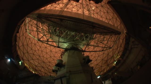 Low Angle static _ A radio telescope rotates on its base / Cambridge, Massachusetts, USA