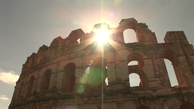 Low Angle static _ Sunlight shines through the Roman ruins at El Djem / Mahdia Governorate, Tunisia