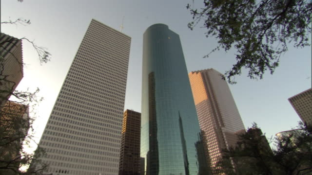 Low Angle static - Glass skyscrapers reflect adjacent buildings in Houston. / Houston, Texas, USA