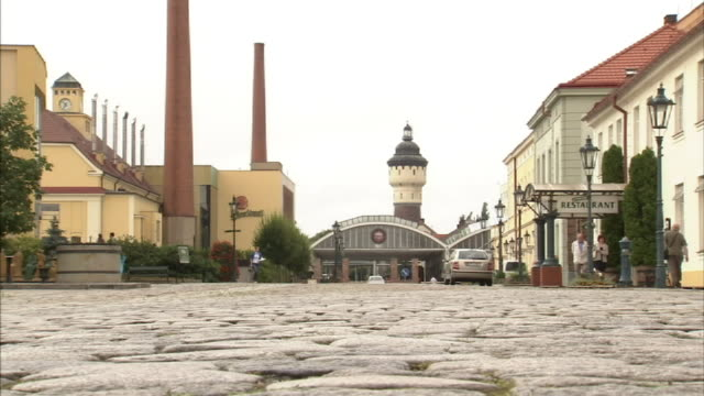 low angle static-a restaurant is across a cobblestone street from the pilsner urquell brewery.   - czech republic stock videos & royalty-free footage