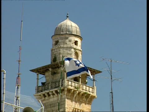 ms low angle, stone tower, israeli flag flying, television aerials, jerusalem - jerusalem stock videos and b-roll footage