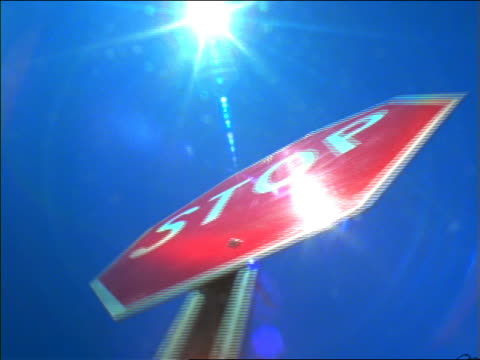 "low angle pan ""stop"" sign / sun in background / new mexico - octagon stock videos and b-roll footage"