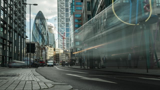 low angle street view looking down bishopsgate towards the city of london with  large modern office blocks in the foreground and rapidly moving blurred city traffic - london england stock videos & royalty-free footage