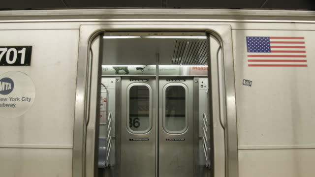 low angle, subway stops at station and opens door - underground rail stock videos & royalty-free footage