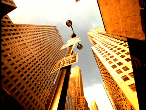 sepia low angle pan tall city buildings / nyc - getönt stock-videos und b-roll-filmmaterial