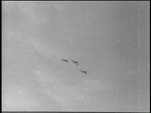 b/w 1951 low angle pan three mig 15s flying overhead / korean war / educational - 1951年点の映像素材/bロール
