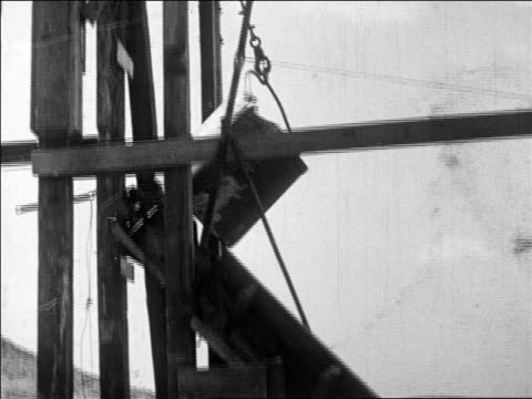 b/w 1927 low angle tilt down bucket pouring out dirt + rocks at gold mine / nevada / newsreel - gold mine stock videos and b-roll footage