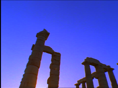 low angle tilt down pilars of temple of poseidon / cape sounion, greece - sounion stock videos and b-roll footage