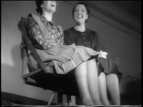 b/w 1933 low angle tilt down women in bouncing chair in vibration-tester experiment / purdue u., indiana / news. - 1933 stock videos & royalty-free footage