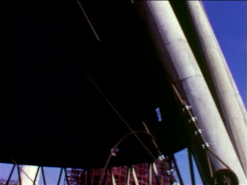 1965 low angle tilt up cooling tower of nuclear power plant under construction / pennsylvania / documentary - nuclear energy stock videos & royalty-free footage
