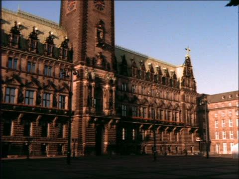 low angle tilt up of rathaus (city hall) / hamburg, germany - rathaus hamburg stock-videos und b-roll-filmmaterial