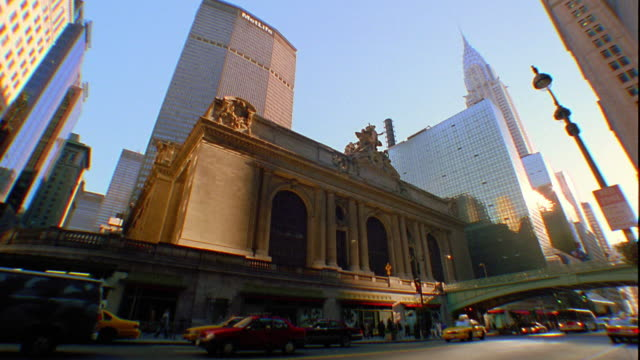 low angle tilt up tilt down grand central station with traffic in front / chrysler and met life buildings in background / manhattan, new york city - 2001 stock videos and b-roll footage
