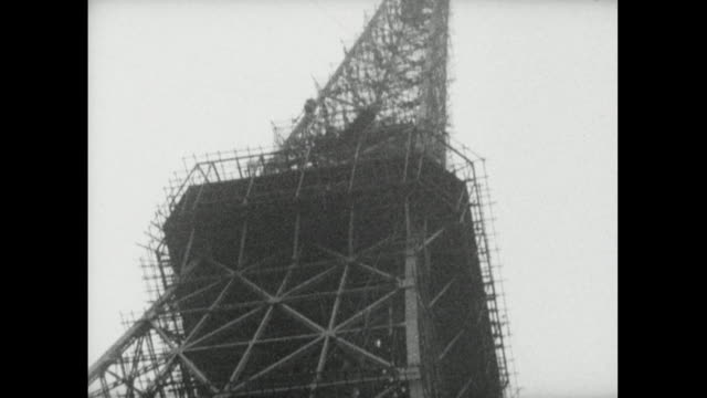 low angle tilt up tokyo tower against sky; 1959 - replica della torre eiffel video stock e b–roll