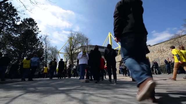 low angle tilted mid shot of fans heading for the game signal iduna park general view at signal iduna park on april 20 2013 in dortmund federal... - borussia dortmund stock videos and b-roll footage