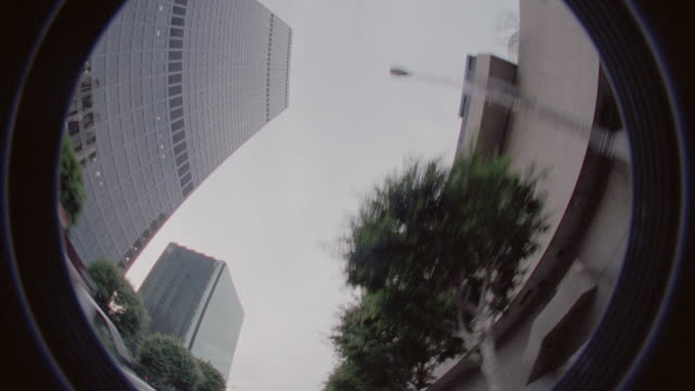 FISHEYE low angle time lapse car point of view past skyscrapers in Los Angeles during day