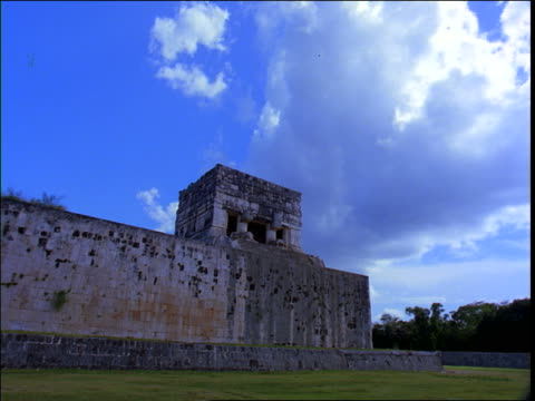 low angle time lapse clouds in blue sky over mayan ruins / mexico - latin american civilizations stock videos and b-roll footage