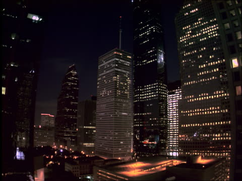 low angle time lapse dusk to night skyscrapers / downtown Houston, Texas