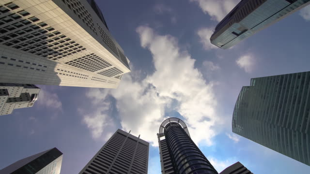 Low angle time lapse of Skyscrapers in financial district of Singapore
