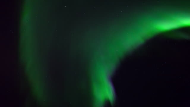 low angle time lapse shot of natural green lights against stars in sky at night - northwest territories, canada - aurora polaris stock videos & royalty-free footage