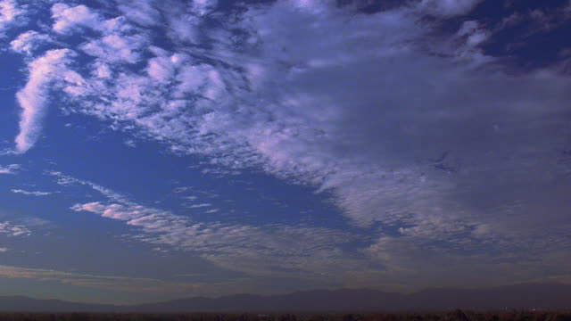 Low angle time lapse thin clouds moving oin sky