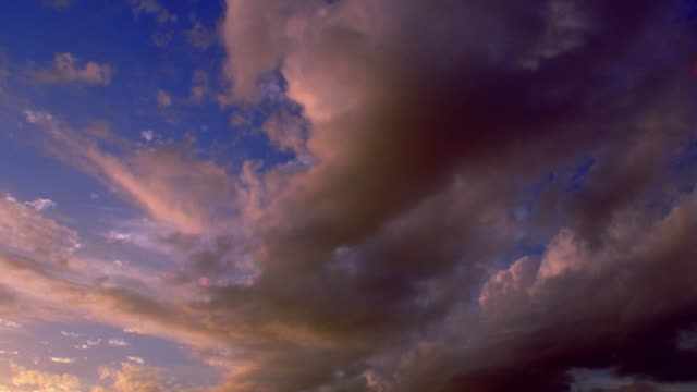low angle time lapse two layers of clouds moving in different directions darkening at sunset / colorado - 1 minute or greater stock videos & royalty-free footage