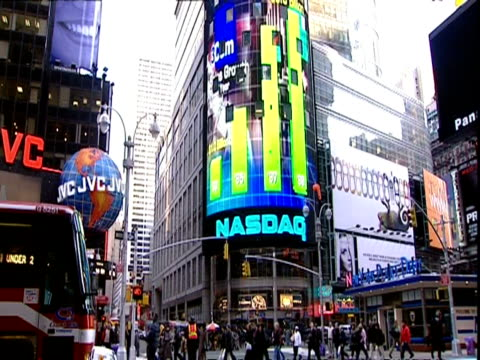 wa low angle, times square area intersection featuring huge nasdaq video screen, new york - ナスダック点の映像素材/bロール