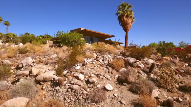 ts low angle towards classic mid-century modern 1954 house on rock strewn hillside in palm springs - modern rock stock videos & royalty-free footage