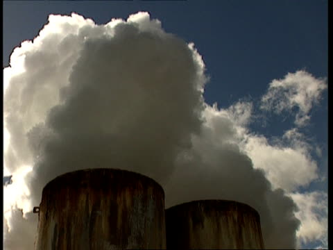 cu low angle, towers billowing out white steam against blue sky - moving up stock videos & royalty-free footage