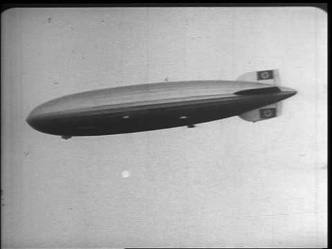 b/w 1937 low angle tracking shot hindenburg flying - 1937 stock videos and b-roll footage