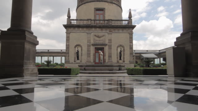 Low angle tracking shot moving across a black and white tiled floor at Chapultepec Castle.