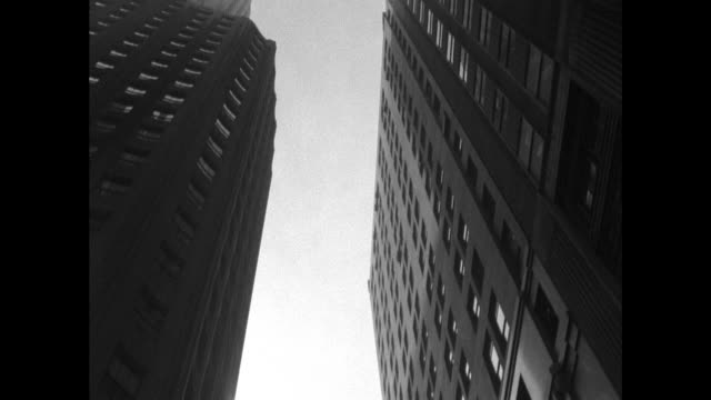 low angle tracking shot of new york skyscrapers - black and white stock videos & royalty-free footage