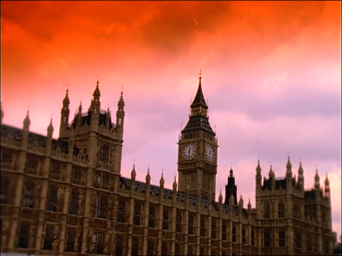 low angle tracking shot of parliament building + big ben / london / filter - houses of parliament london stock videos & royalty-free footage