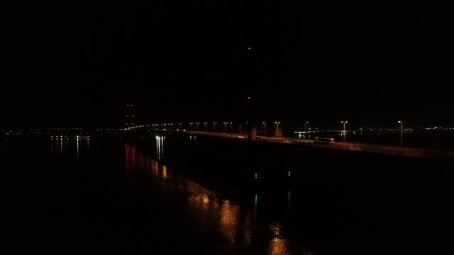 low angle tracking shot of the humber bridge at night - hull stock videos & royalty-free footage