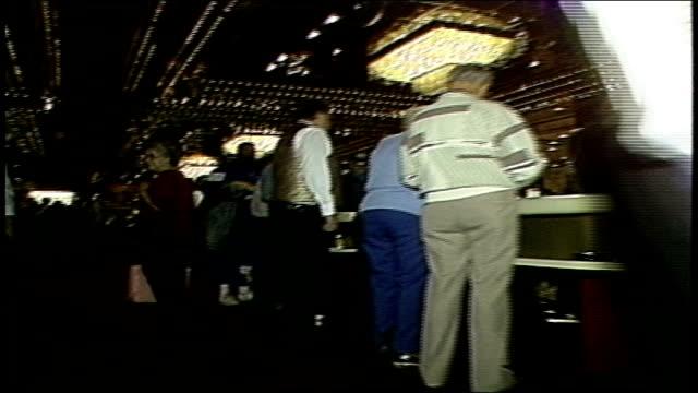 low angle tracking shot through casino floor - casino floor stock videos & royalty-free footage
