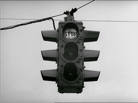 "b/w 1952 low angle traffic light changing from ""stop"" to ""go"" - 1952 stock videos & royalty-free footage"