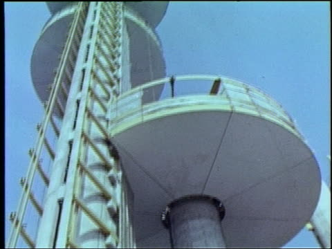 1964 low angle unusual tower with balcony at ny world's fair - esposizione universale di new york video stock e b–roll
