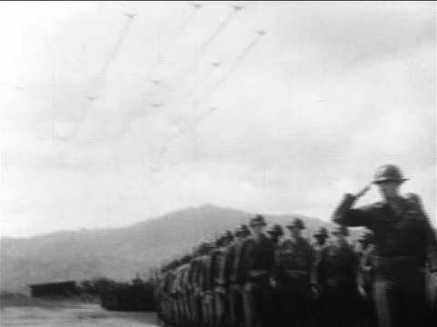 PAN low angle US troops marching in parade / tilt up warplanes flying in formation / End of Korean War