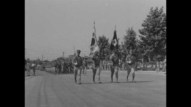 stockvideo's en b-roll-footage met low angle view american soldiers marching past camera on right / vs tanks of the us 31st infantry rumble past / various south korean military units... - chiang kai shek