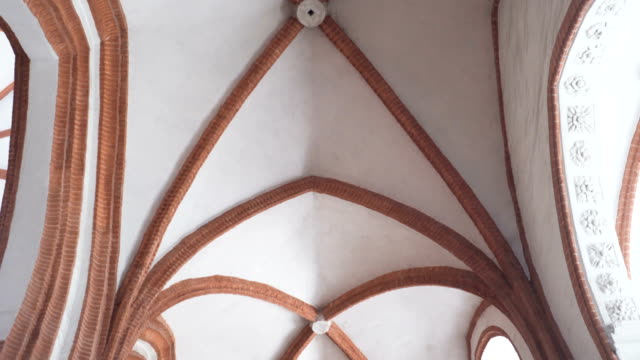 low angle view: arch of polish church in wroclaw, poland - arch architectural feature stock videos and b-roll footage