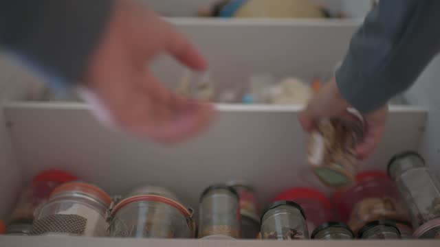low angle view asian chinese male retrieving food bottle from shelf cabinet at kitchen - storage compartment stock videos & royalty-free footage