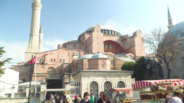 low angle view during walking on entrance the street to see national landmark:  building exterior of the mosque in istanbul- hagia sophia mosque, a religious symbol and turkish culture under the white sky in the morning in istanbul, turkey. - religious symbol stock videos & royalty-free footage