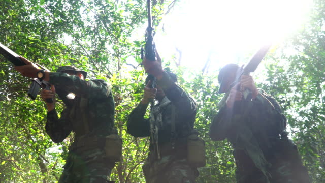 low angle view: gesture of fully Equipped and armed Soldiers is ready to fight