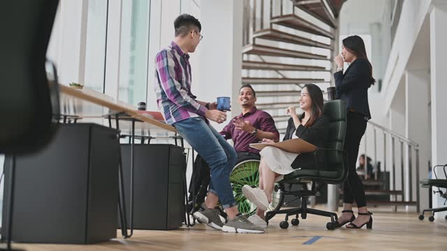 low angle view indian businesssman in wheelchair leading group discussion in creative office - business casual stock videos & royalty-free footage